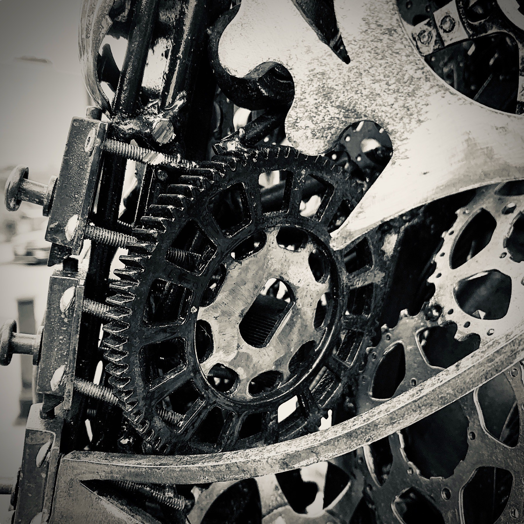 Close up of bicycle gears and sprockets from a sculpture.