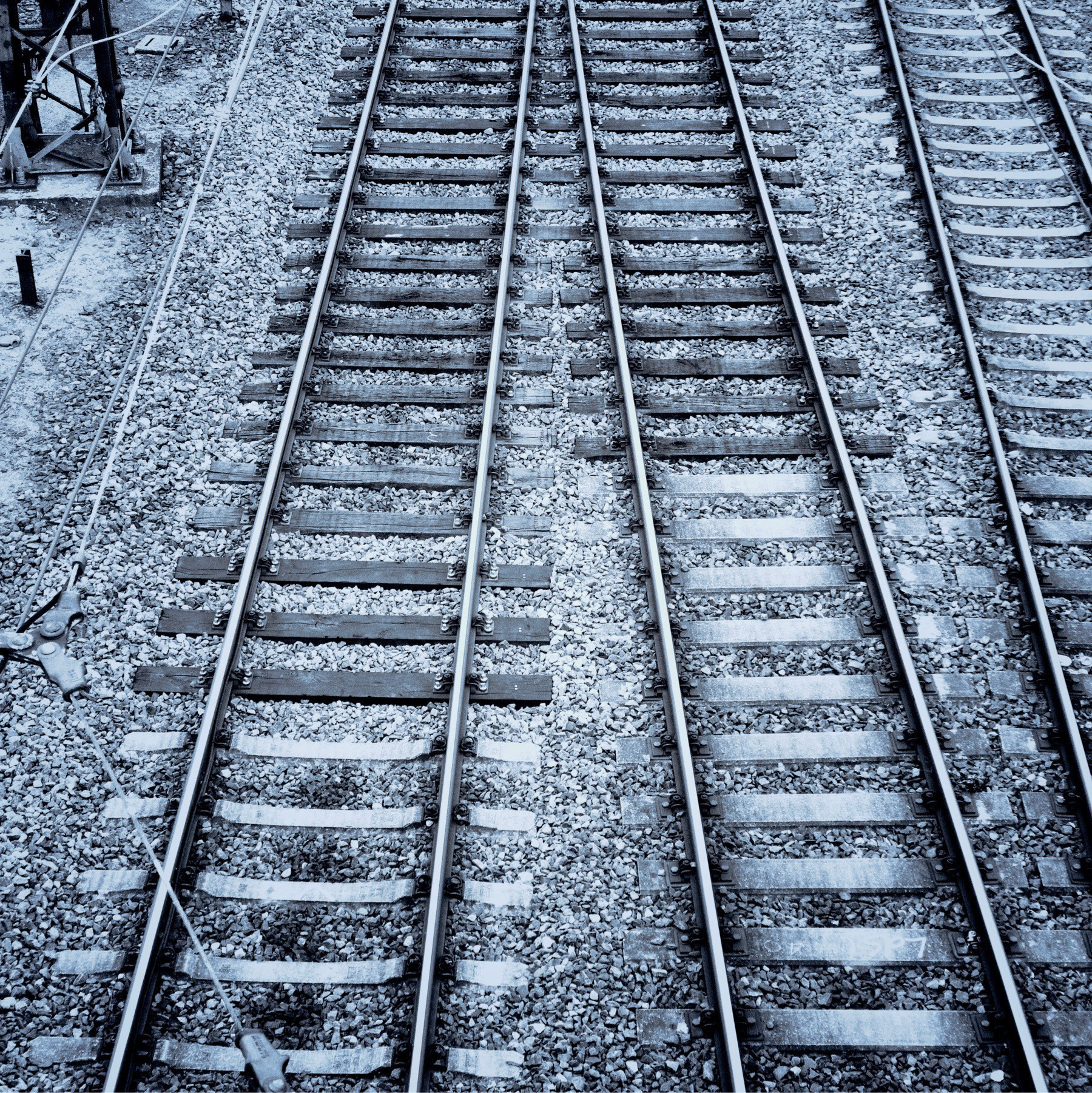 Black and White photo of train tracks.
