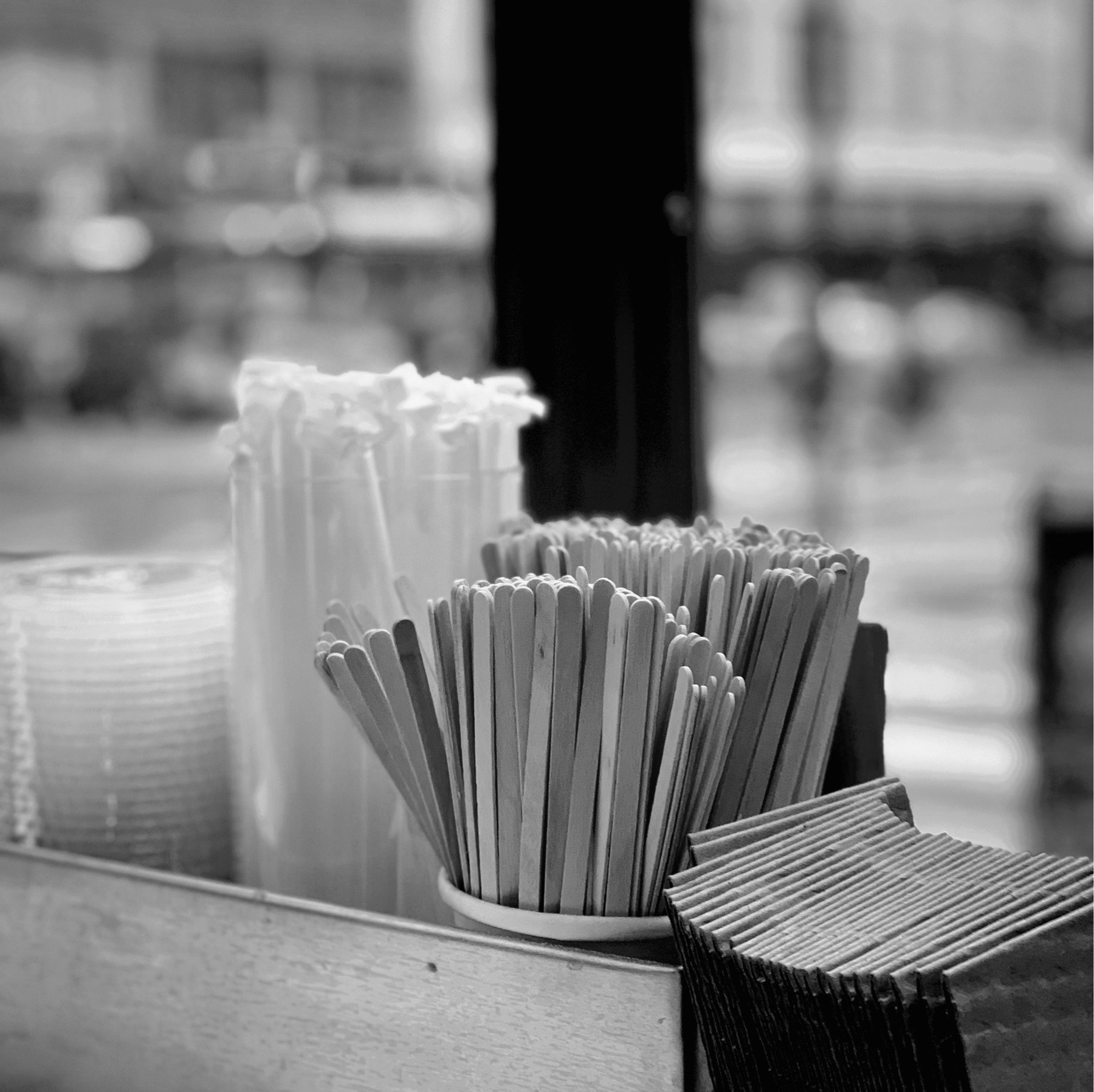 Straws and stirrers in a cafe window.