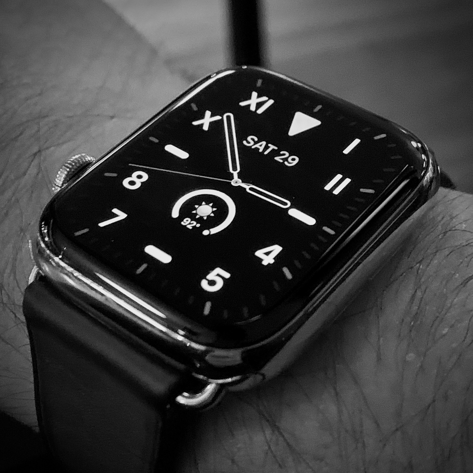 Apple Watch on wrist with California watch face, showing 2:53 pm.