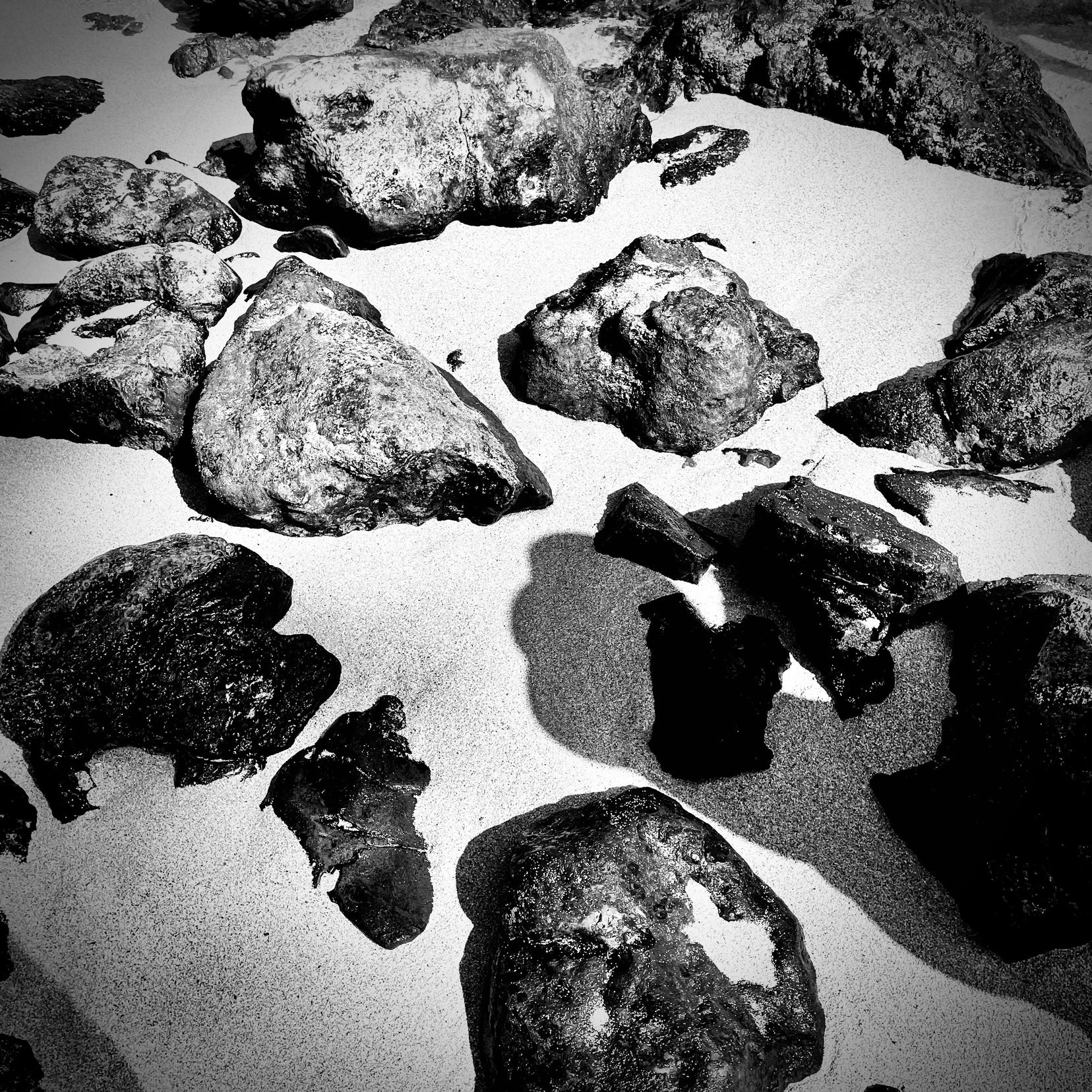 Rocks and sand, black and white.
