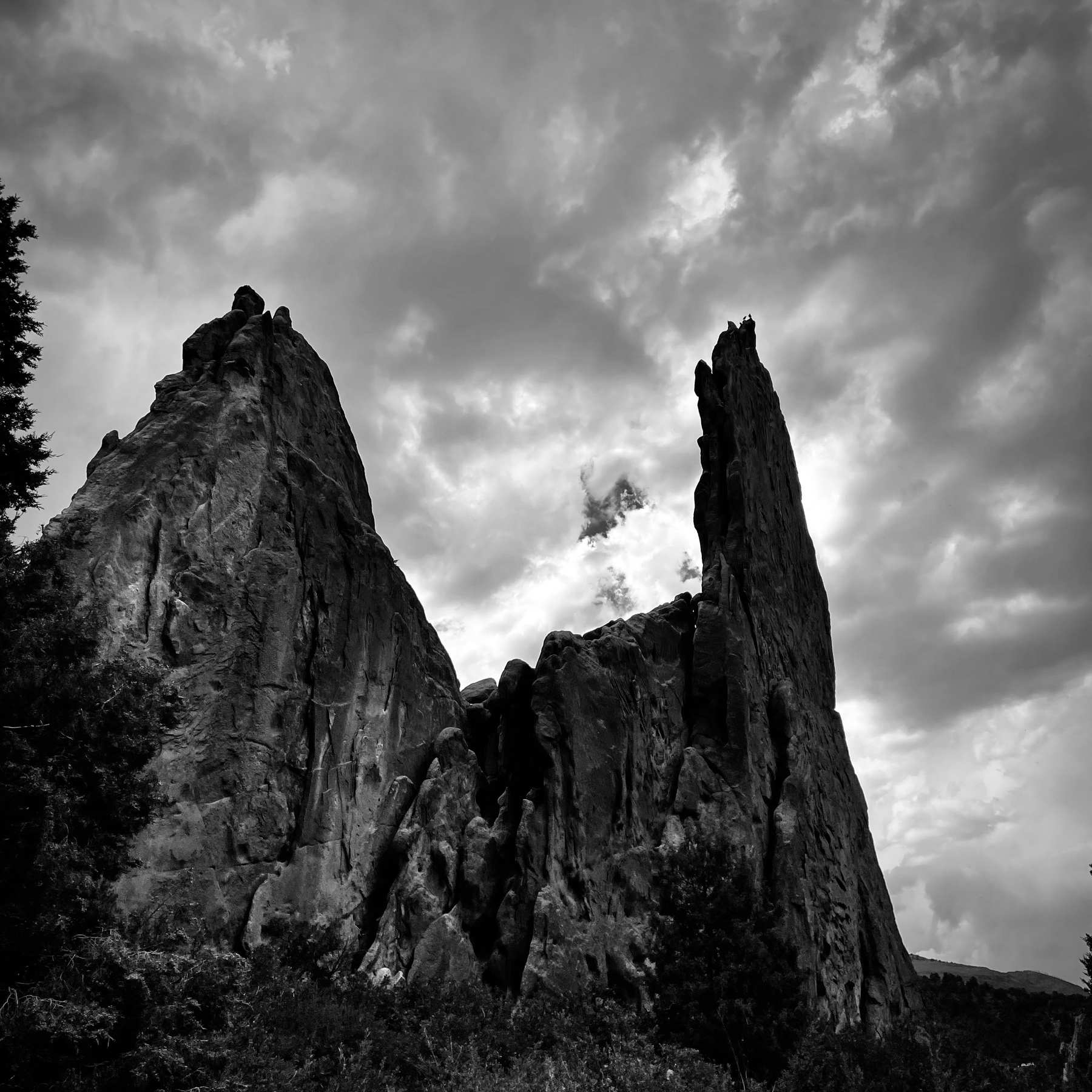 stone structure over cloudy sky, black and white
