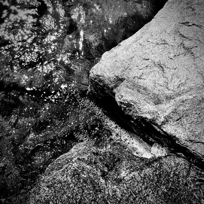 Wster flowing over rocks.