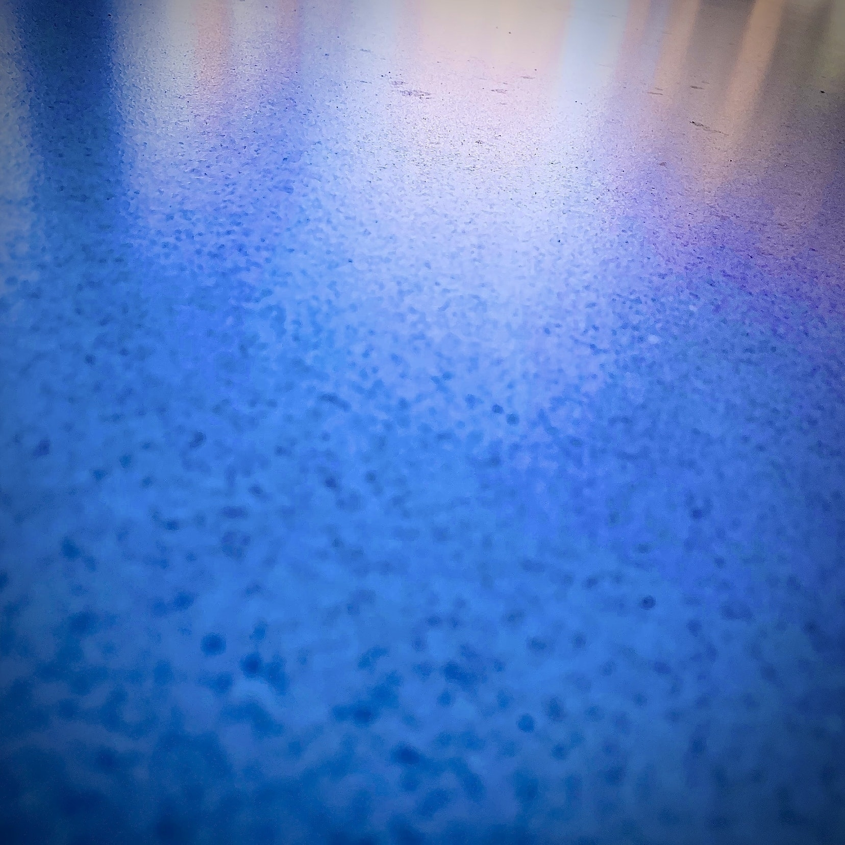 Abstract of stone table top with intense saturation